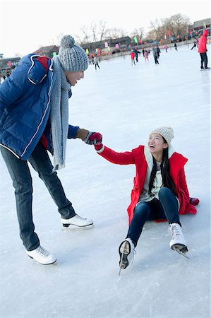 Young couple at ice rink Stock Photo - Premium Royalty-Free, Code: 6116-07086574