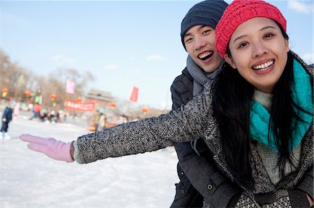 Young couple at ice rink Stock Photo - Premium Royalty-Free, Code: 6116-07086575