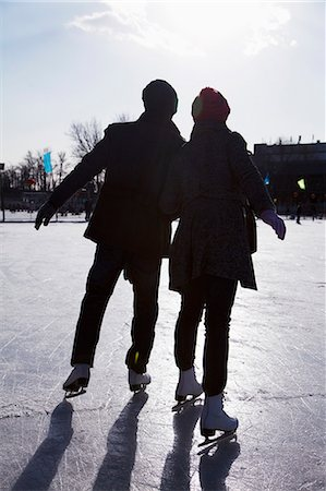 Young couple at ice rink Stock Photo - Premium Royalty-Free, Code: 6116-07086576