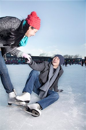 Young couple at ice rink Stock Photo - Premium Royalty-Free, Code: 6116-07086578