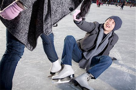 Young couple at ice rink Stock Photo - Premium Royalty-Free, Code: 6116-07086579