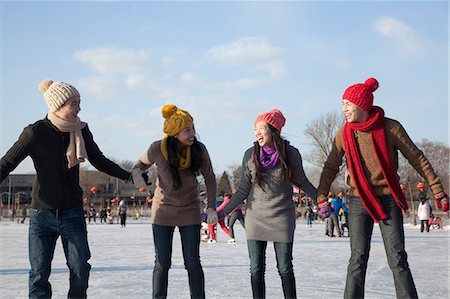 Friends on ice rink Stock Photo - Premium Royalty-Free, Code: 6116-07086580