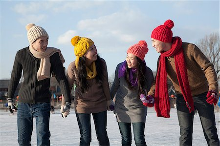 Friends on ice rink Stock Photo - Premium Royalty-Free, Code: 6116-07086581