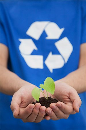 dirt - Young Man Holding Seedling in his Hands, Recycling Symbol, Close Up Stock Photo - Premium Royalty-Free, Code: 6116-07235489