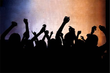 A crowd of young people dancing in a nightclub Stock Photo - Premium Royalty-Free, Code: 6116-07235661