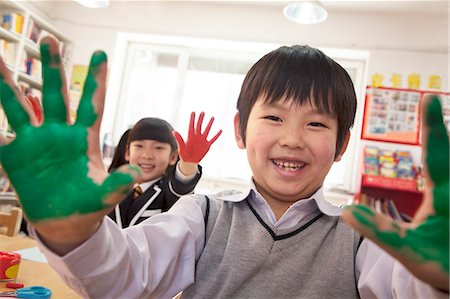 finger painting - School children showing their hands covered in paint Stock Photo - Premium Royalty-Free, Code: 6116-07235677