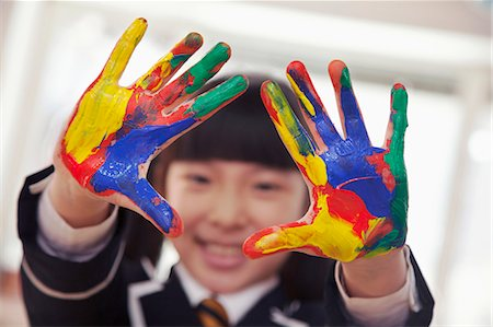 finger painting - Smiling schoolgirl finger painting, close up on hands Stock Photo - Premium Royalty-Free, Code: 6116-07235680