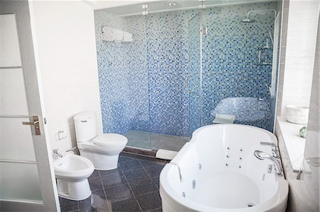 Modern, clean, bathroom with toilet, sink, shower and bathtub. Stock Photo - Premium Royalty-Free, Code: 6116-07235707