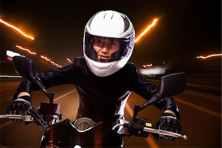 Young woman riding a motorcycle through the streets of Beijing, light trails Stock Photo - Premium Royalty-Free, Code: 6116-07235908