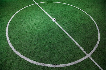 Soccer field with soccer ball on the line, high angle view Stock Photo - Premium Royalty-Free, Code: 6116-07236131