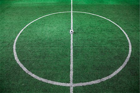 Soccer field with soccer ball on the line, high angle view Stock Photo - Premium Royalty-Free, Code: 6116-07236132