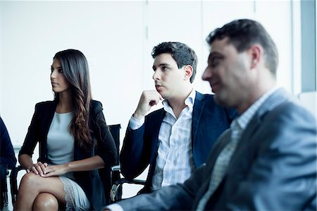 four - Business people sitting in a business meeting Stock Photo - Premium Royalty-Free, Code: 6116-07236583