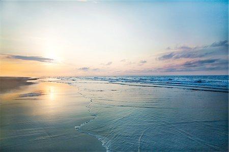 View of beach sunrise Stock Photo - Premium Royalty-Free, Code: 6116-08805952