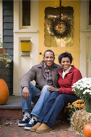 Couple outside house Stock Photo - Premium Royalty-Free, Code: 6116-08945538