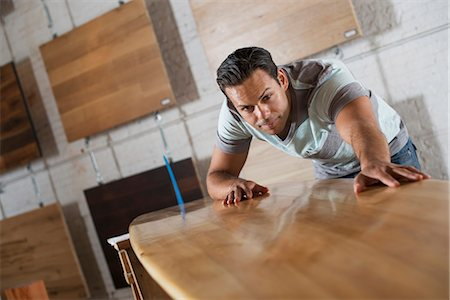 A Young Man In A Workshop With Stock Of Recycled And Reclaimed Timber. Stock Photo - Premium Royalty-Free, Code: 6118-07121806