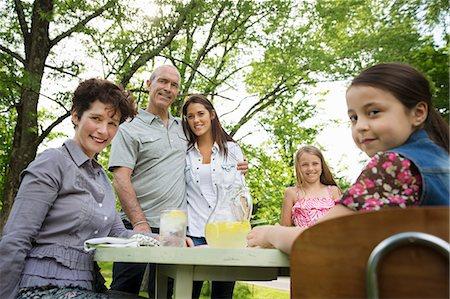 A Summer Family Gathering At A Farm. A Family Group, Parents And Children. Making Fresh Lemonade. Stock Photo - Premium Royalty-Free, Code: 6118-07122164