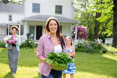 Family Party. Parents And Children Walking Across The Lawn Carrying Flowers, Fresh Picked Vegetables And Fruits. Preparing For A Party. Stock Photo - Premium Royalty-Free, Code: 6118-07122192