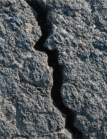 A Lava Field, With Black Solidified Rock Surface, With Fissures. Stock Photo - Premium Royalty-Free, Code: 6118-07122110