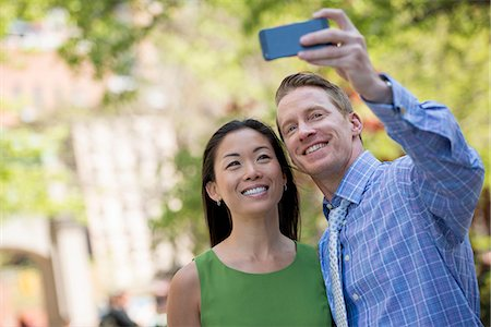 settlement - A Couple, A Man And Woman Taking A Selfy With A Smart Phone. Stock Photo - Premium Royalty-Free, Code: 6118-07122457