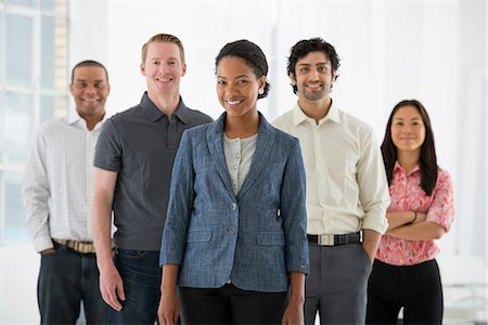 Business. A Team Of People, A Multi Ethnic Group, Men And Women In A Group. Stock Photo - Premium Royalty-Free, Code: 6118-07122578