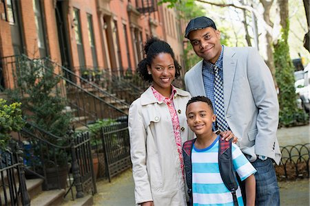 A Family Outdoors In The City. Two Parents And A Young Boy Walking Together. Stock Photo - Premium Royalty-Free, Code: 6118-07122518