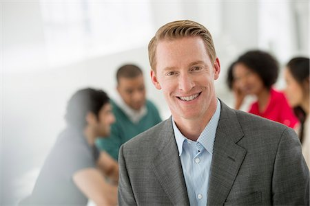 Business Meeting. A Man Smiling Confidently. Stock Photo - Premium Royalty-Free, Code: 6118-07122630