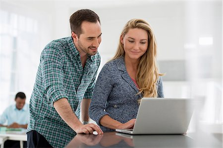 settlement - Office Interior. A Couple At A Table Looking At A Computer Screen. Stock Photo - Premium Royalty-Free, Code: 6118-07122722
