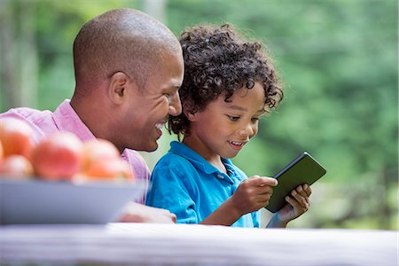 farm phone - A picnic on the farm. Fresh organic fruit on the table. A father and son sitting together. Stock Photo - Premium Royalty-Free, Code: 6118-07203063