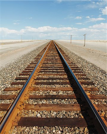 A railroad extending through the desert, near Wendover in Utah. Stock Photo - Premium Royalty-Free, Code: 6118-07203200