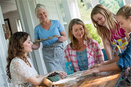 Farmhouse in the country in New York State. Four generations of women in a family baking cookies and apple pie. Stock Photo - Premium Royalty-Free, Code: 6118-07203430