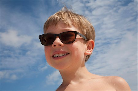 dark glasses - A young boy wearing sunglasses. Stock Photo - Premium Royalty-Free, Code: 6118-07203854