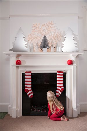 decoration pattern - A young girl looking expectantly up the chimney awaiting the arrival of Father Christmas. Stock Photo - Premium Royalty-Free, Code: 6118-07203835