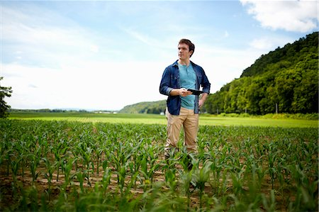 A farmer working in his fields in New York State, USA. Stock Photo - Premium Royalty-Free, Code: 6118-07203905