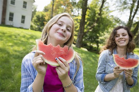 preteen girl - A family summer gathering at a farm. A shared meal, a homecoming. Stock Photo - Premium Royalty-Free, Code: 6118-07235035
