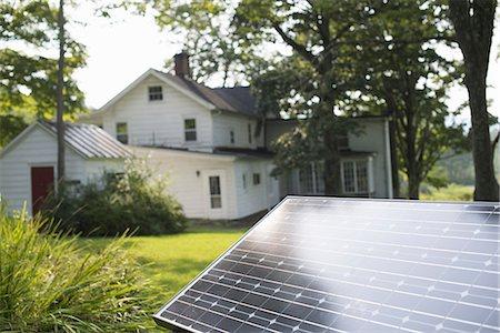 solar panel usa - A solar panel in a farmhouse garden. Stock Photo - Premium Royalty-Free, Code: 6118-07235245
