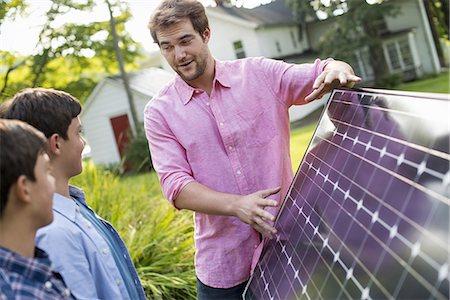 solar panel usa - Two people walking towards a farmhouse garden. Stock Photo - Premium Royalty-Free, Code: 6118-07235253
