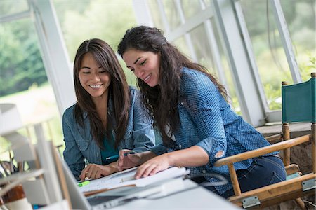drawing computer - Two women working together, looking at the screen of a digital tablet. Stock Photo - Premium Royalty-Free, Code: 6118-07351175
