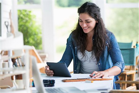 drawing computer - A woman working at a table, using a digital tablet. Stock Photo - Premium Royalty-Free, Code: 6118-07351179