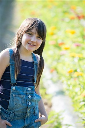 preteen girl pigtails - Summer on an organic farm. A young girl in a field of flowers. Stock Photo - Premium Royalty-Free, Code: 6118-07351123