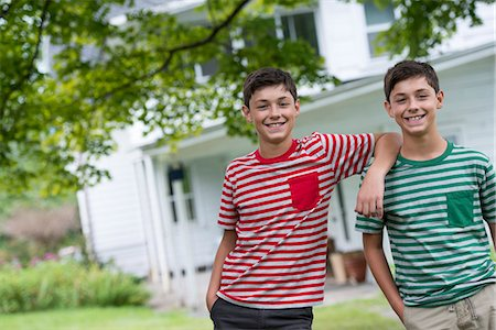 Two boys in a farmhouse garden in summer. Stock Photo - Premium Royalty-Free, Code: 6118-07351226