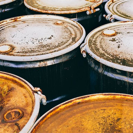 A group of rusted corroded barrels of chemical or petroleum products. Stock Photo - Premium Royalty-Free, Code: 6118-07351309