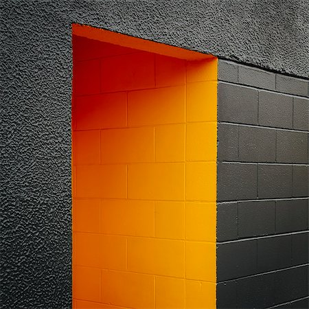 painting - A doorway recess, painted orange in a grey block concrete wall. Stock Photo - Premium Royalty-Free, Code: 6118-07351316