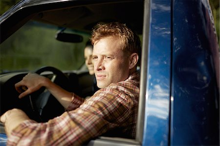 female truck driver - A pick up truck. A man at the wheel looking out of the window, with a young woman beside him. Stock Photo - Premium Royalty-Free, Code: 6118-07351666