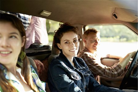 female truck driver - Three passengers in the cab of a pickup truck. One young man driving. Two young women sitting beside him. Stock Photo - Premium Royalty-Free, Code: 6118-07351668