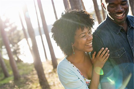 person - A happy couple in a shady spot in woodland in summer. Hugging and holding each other. Stock Photo - Premium Royalty-Free, Code: 6118-07351608