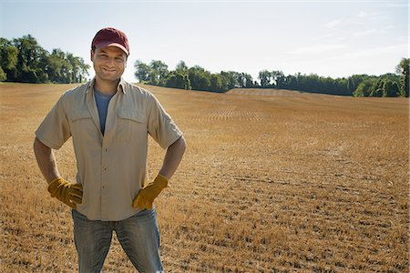 plow - A man standing by a freshly ploughed field. Stock Photo - Premium Royalty-Free, Code: 6118-07352066