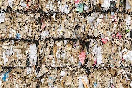 Recycling facility with bundles of cardboard sorted and tied up for recycling. Stock Photo - Premium Royalty-Free, Code: 6118-07352264