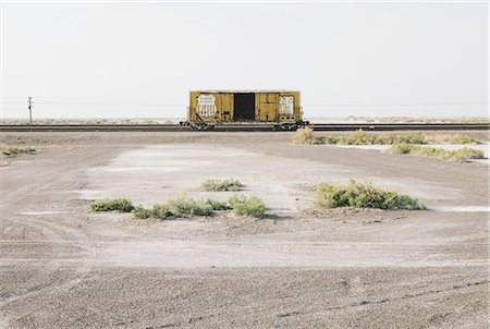 empty - An empty box car or freight wagon on the train tracks in the desert. Photographie de stock - Premium Libres de Droits, Code: 6118-07352507