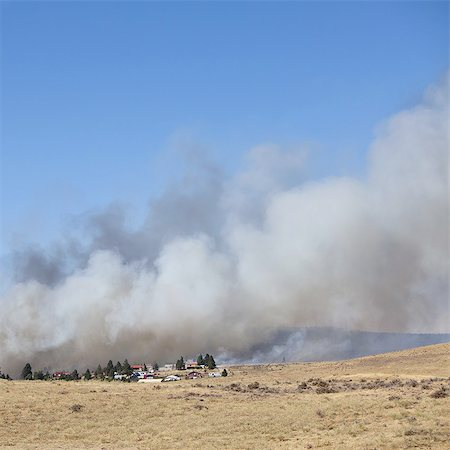 smoke - A large forest fire near Ellensburg in Kittitas county, Washington state, USA. Stock Photo - Premium Royalty-Free, Code: 6118-07352522