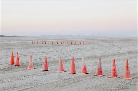 repeating - Row of traffic cones on the flat desert surface of  Black Rock, Nevada. Stock Photo - Premium Royalty-Free, Code: 6118-07352741